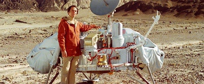 Carl Sagan with model of the Viking lander